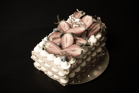 puff: Puff homemade cake with cream and berries. Toned.