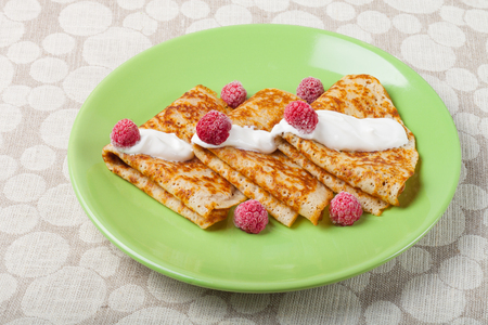 blini: Russian pancakes - blini with sour cream topping. Selective focus. Stock Photo
