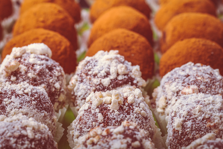 Set of different kinds of homemade chocolate truffles. Selective focus. Shallow depth of field. Toned.