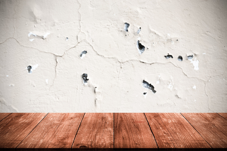 Light plastered wall with crack. Background. View from dark wooden gangway, table or bridge. Collage. Toned.