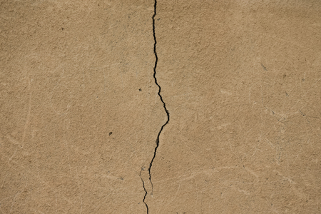 parget: Light plastered wall with crack for background. Close up detail. Toned.