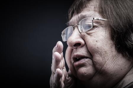 Portrait of elderly woman. Secret. Toned.