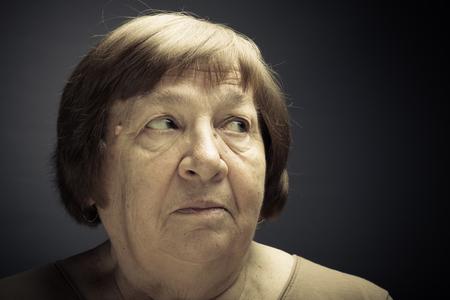 Portrait of elderly woman. Wonder. Toned.