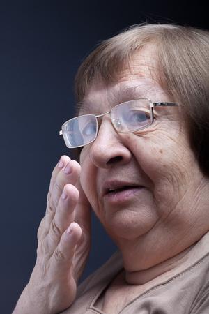 Portrait of elderly woman. Secret.