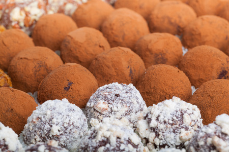 Set of different kinds of homemade chocolate truffles. Selective focus. Shallow depth of field.