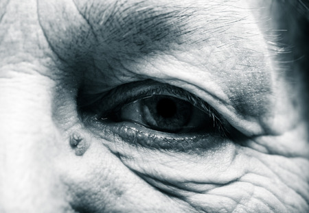 grayness: Part of portrait of elderly woman. Eyes. Toned. Stock Photo