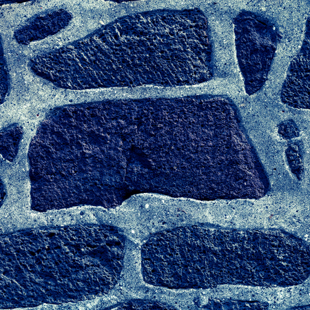 Texture of natural stones on the wall of traditional Iceland house for background. Toned.