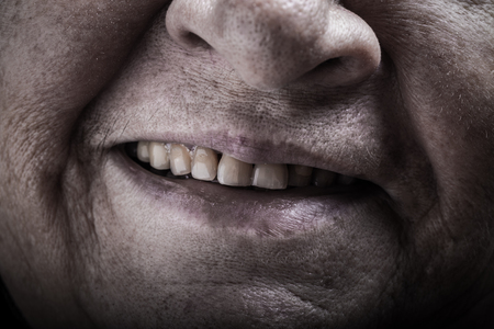 grayness: Part of portrait of elderly woman. Mouth. Toned. Stock Photo