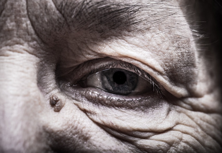 grayness: Part of portrait of elderly woman Eyes. Toned.