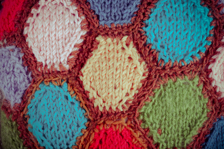 Knitted pattern from woolen warm soft yarn for background.