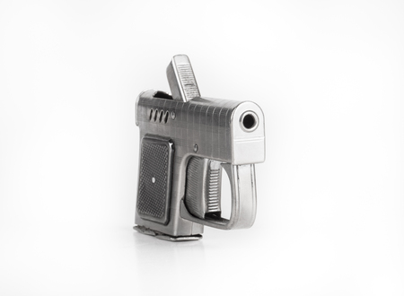 gas lighter: Lighter in the form of a gun on a light background. Stock Photo