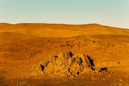 Orange stony deserted landscape of Iceland. Toned. Stock Photo