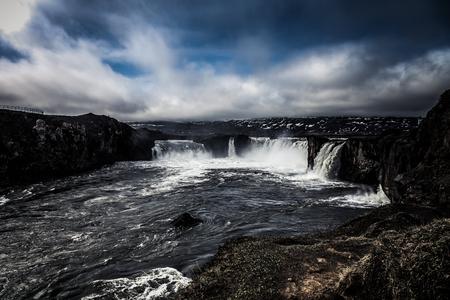 The Godafoss Waterfall - beautiful part of stony rocky desert landscape of Iceland. Toned. Stock Photo