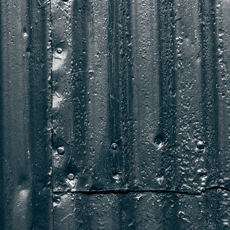 weathered: Texture of corrugated metal on the wall of traditional Iceland house for background. Toned.
