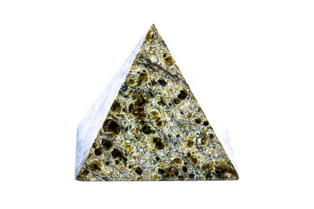 Stone pyramide on a white background. Toned.