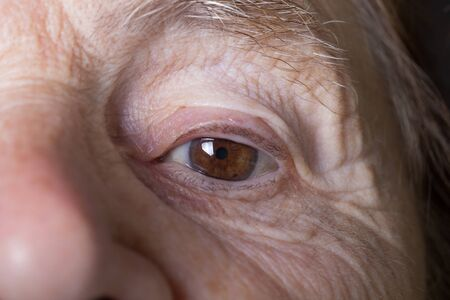 grayness: Portrait of elderly woman. Close-up detail.