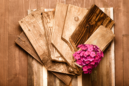 plywood: Flower on a rough weathered wooden board. Rustic texture for background. Toned.