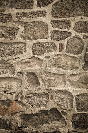 Wall built of natural stone. Toned.