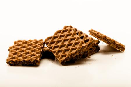 Chocolate waffels on white background. Toned.