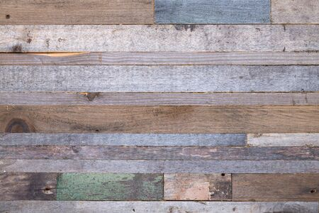 Wooden background from the ends of old boards.