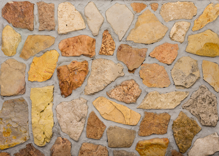 Wall built of natural stone with cement.
