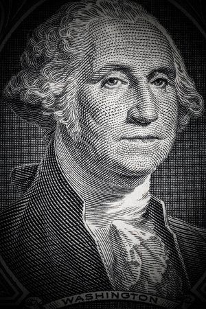 Close up to George Washington portrait on one dollar bill. Toned.