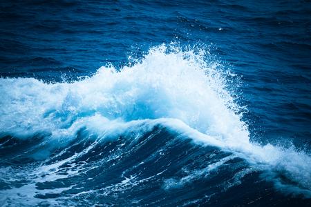White crest of a sea wave. Selective focus. Shallow depth of field. Toned. Lizenzfreie Bilder