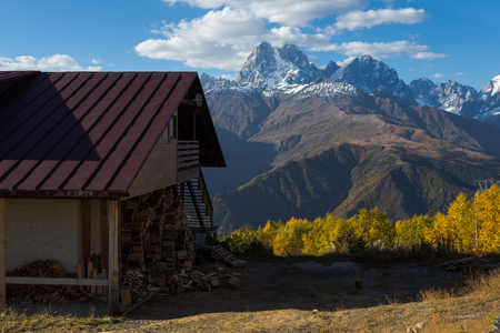Old house and beautiful autumn mountain landscape in Svaneti. Georgia.