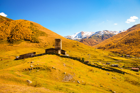 View of the village of Ushguli in a beautiful autumn landscape with white clouds in Svaneti. Georgia. Toned. Stock Photo