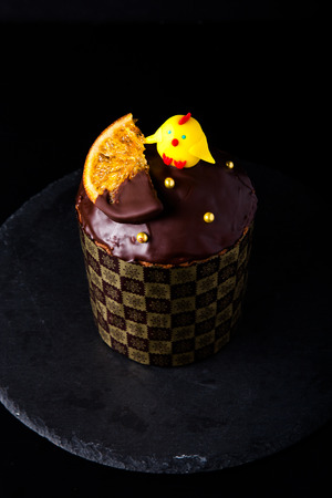 Homemade traditional Easter cake on a dark background.