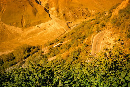 Road serpentine on beautiful autumn mountain landscape in Georgia. Toned. Imagens