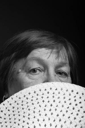 Studio portrait of elderly woman with hat. Coquetry. Toned. Stock fotó