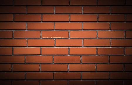 Red brick wall. Wallpaper of ordinary building wall texture Stock Photo