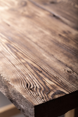 An old board with knots and chips. Wood. Background. Selective focus