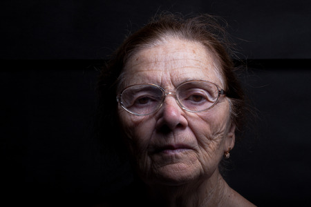 Portrait of an elderly woman with glasses