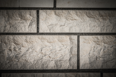 Wall of artificial brick background. Toned. Stock Photo