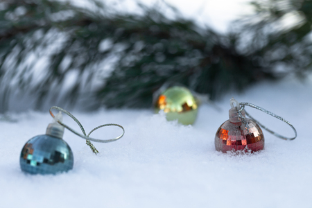 New year and christmas theme with fir branches and snow. Selective focus.
