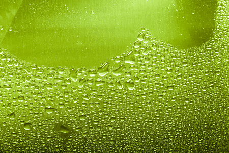 Drops of water on a color background. Gray. Shallow depth of field. Selective focus. Blur Stock Photo
