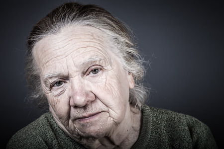 Portrait of elderly woman. Attentive look. Toned.