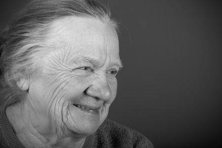 Portrait of elderly woman. Laugh. Toned.