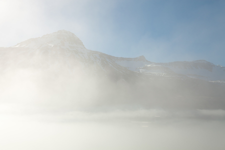 Foggy landscape of the fjords of Iceland.
