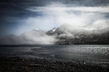 Foggy multicolored spring landscape of Iceland. Toned.