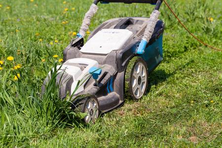 Lawn mower in the spring garden.
