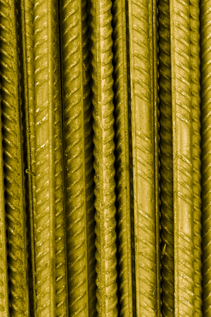 Technogenic background of metal armature bars. Toned. Stock Photo
