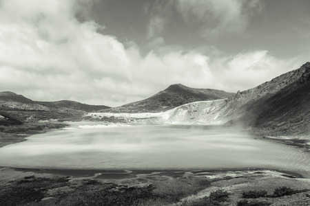 Beautiful landscape in the caldera of the Golovnin volcano on Kunashir island. Toned. 版權商用圖片 - 124707320