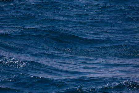 Blue water on the surface of the Pacific Ocean. Natural background.