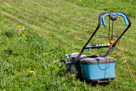 Lawn mower in the spring garden.
