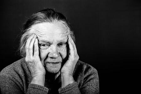 Portrait of elderly woman. Irony. Toned.