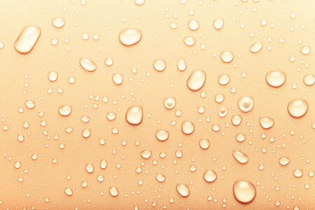 Drops of water on a color background. Orange. Toned.