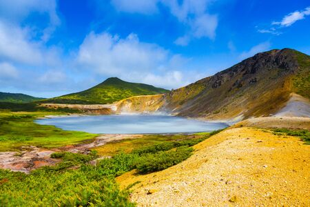 Beautiful landscape in the caldera of the Golovnin volcano on Kunashir island. Toned. Imagens